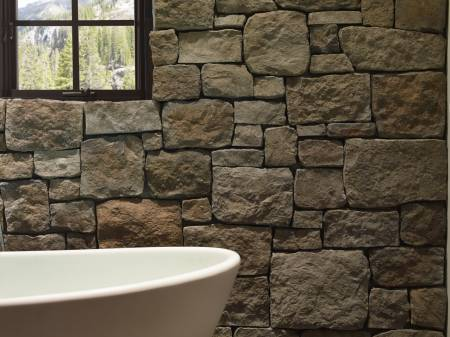 Rustic bathroom after interior stone cladding