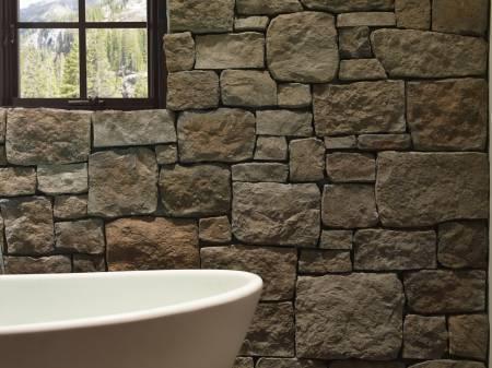 Rustic bathroom after interior stone cladding