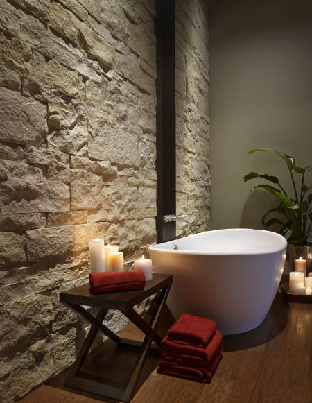 Create a luxury bathroom with faux stone panelling