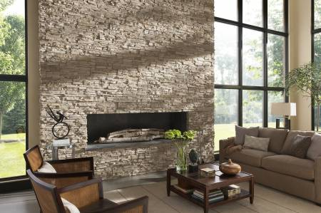 Stone cladding around a fireplace and chimney breast