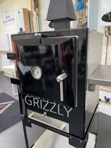 Black outdoor oven on optional trolley