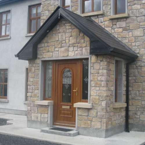 Large front porch clad in Eldorado RoughCut