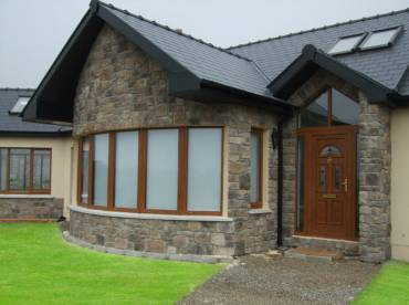 House curved wall cladding around windows