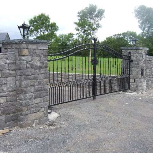 Entrance gates with stone cladding