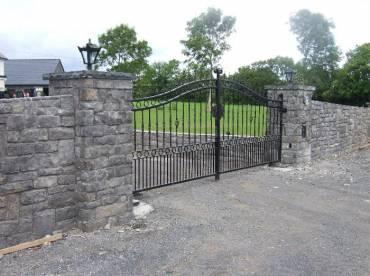 Entrance gates with stone cladding