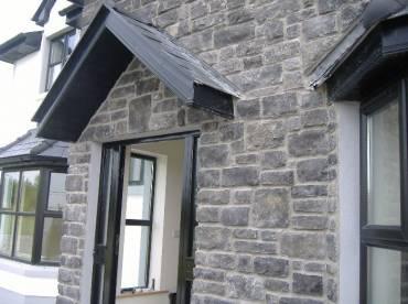 House entrance external wall in grey limestone