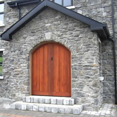 Grand front door in stone cladding