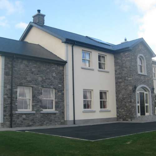 Rendered and stone clad house