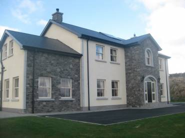 Rendered and stone clad house Hillstone example