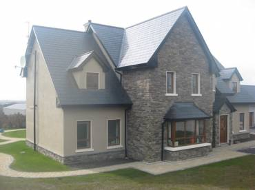 Stone cladding and render house
