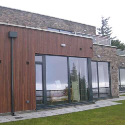 Home exterior wall with Cliffstone Manzanita