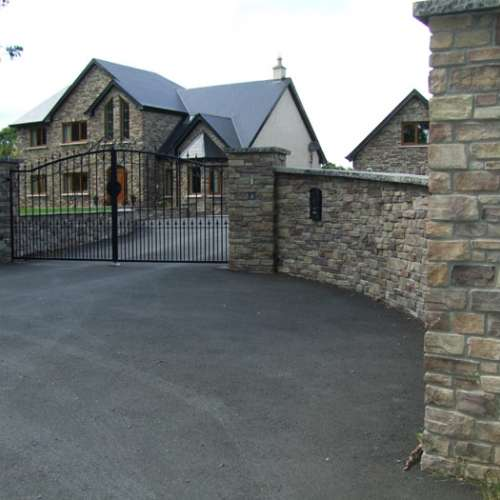 Manzanita garden wall and entrance gate stone cladding