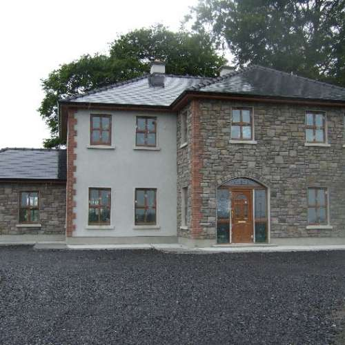 Limestone cladding on rural home