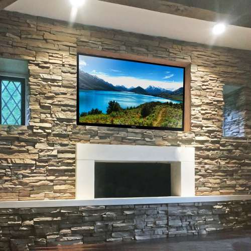 Fireplace and TV surround using Stacked Stone Nantucket